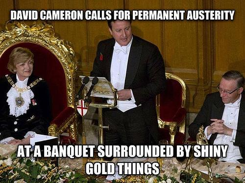 Image of Cameron surrounded by shiny gold things