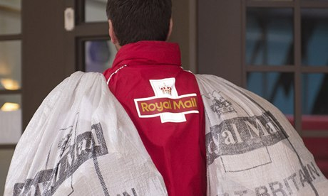 Image of back of postman and post sacks