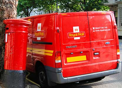 Image of post office van next to postbox