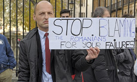 """Image of protest. Placard reads 'Stop blaming the Romanians for your failures!"""""""