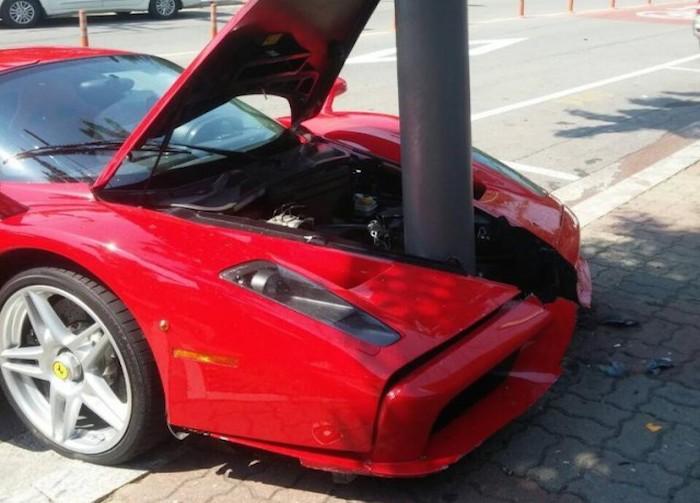 Image of a Ferrari driven into a lampost