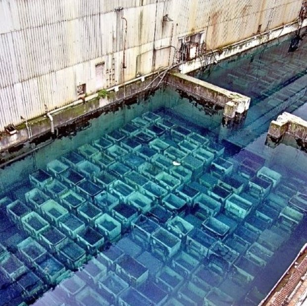 Shitty open-air pond at Sellafield nuclear waste dump containing spent nuclear fuel rods.