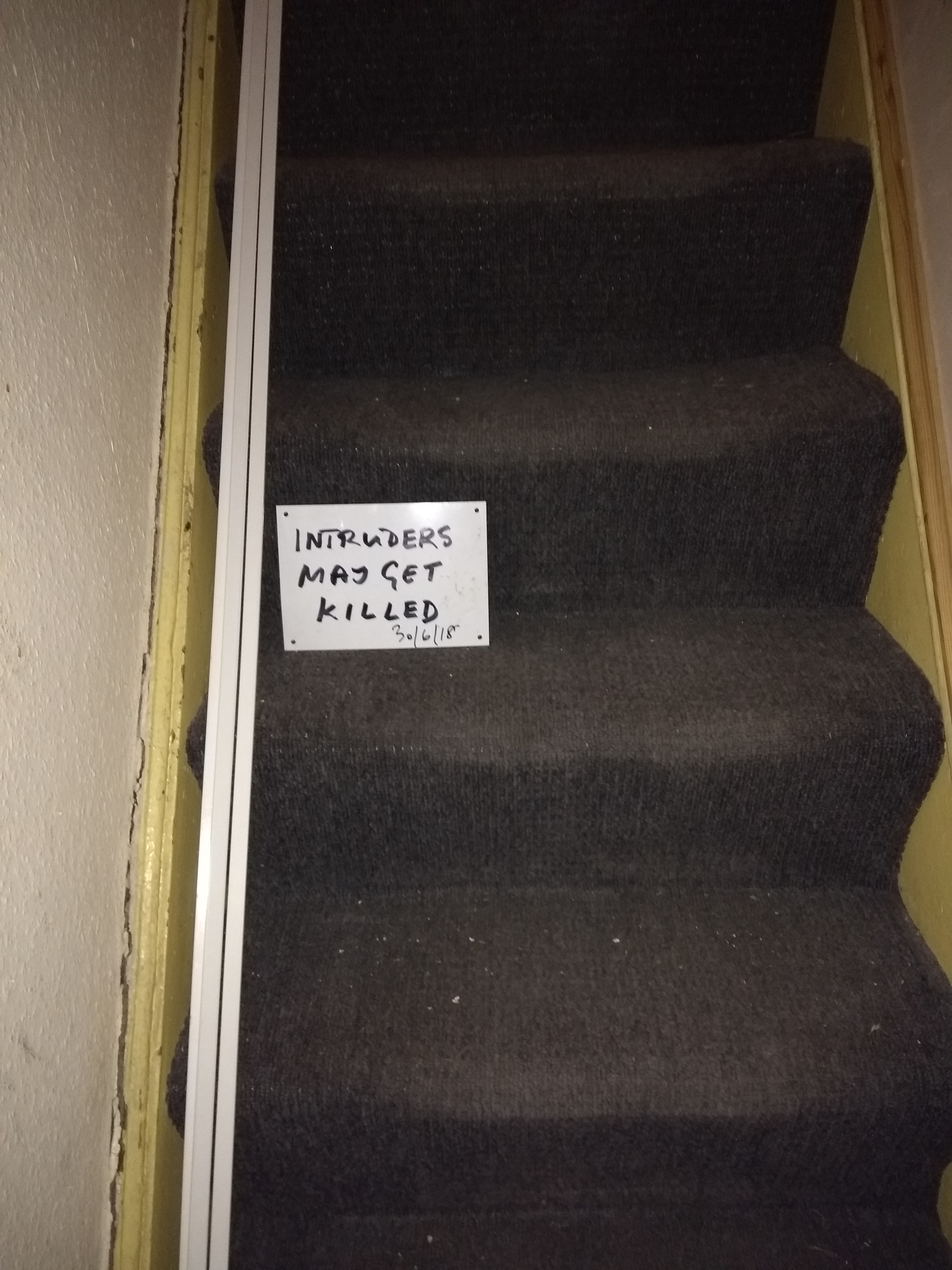 "Warning to landlord reads ""Intruders may get killed"""