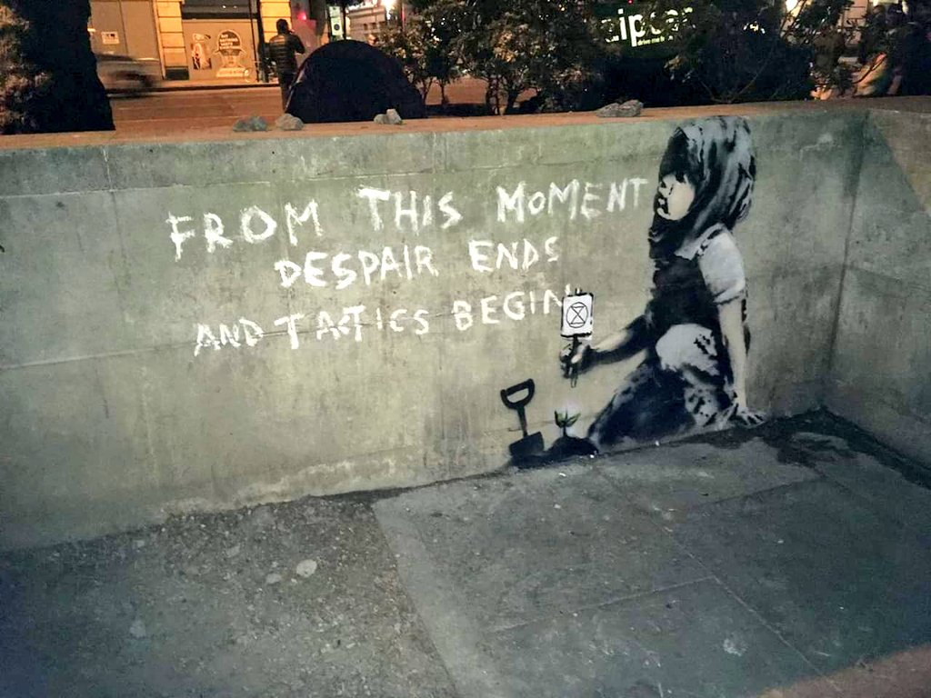 Image at Marble Arch attributed to Banksy following Extinction Rebellion protests 2019 reads 'From this moment despair ends and tactics begin'