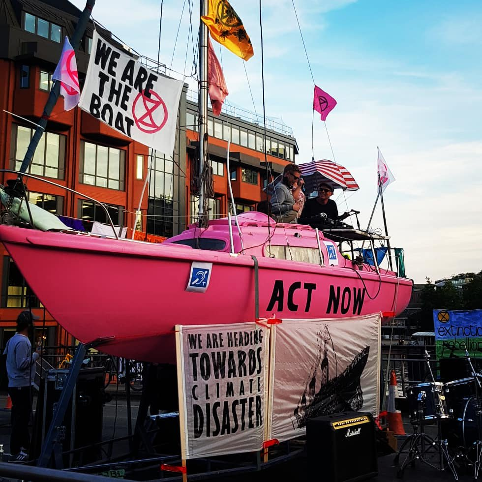 Image of Extinction Rebellions pink boat at Bristol bridge protest 2019.
